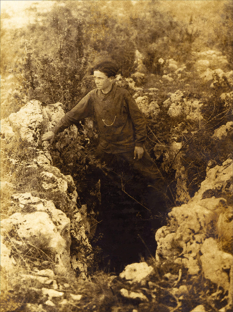 "André David, photographed on the ""iga"" (pothole) giving access to the upper level of the Pech Merle cave (1922 or 1923). From the  Peche Merle Centre ."