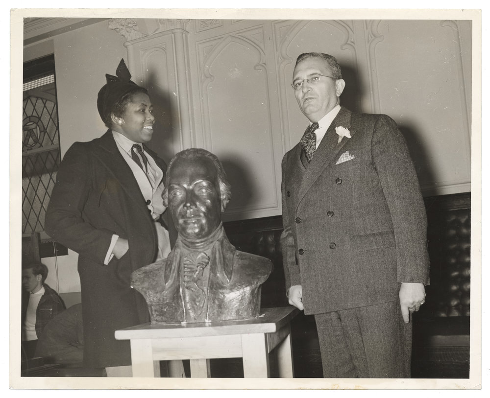 Selma with President Truman, his bust and her flawless ensemble.