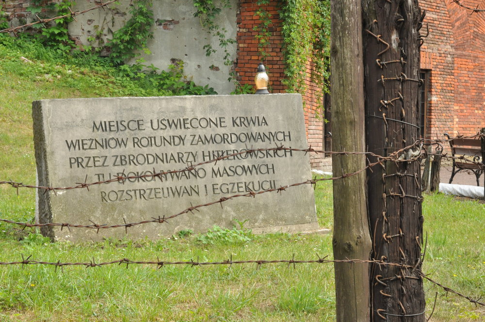 An inscription in the Rotunda in Zamosc, Poland that describes the killings during World War II.