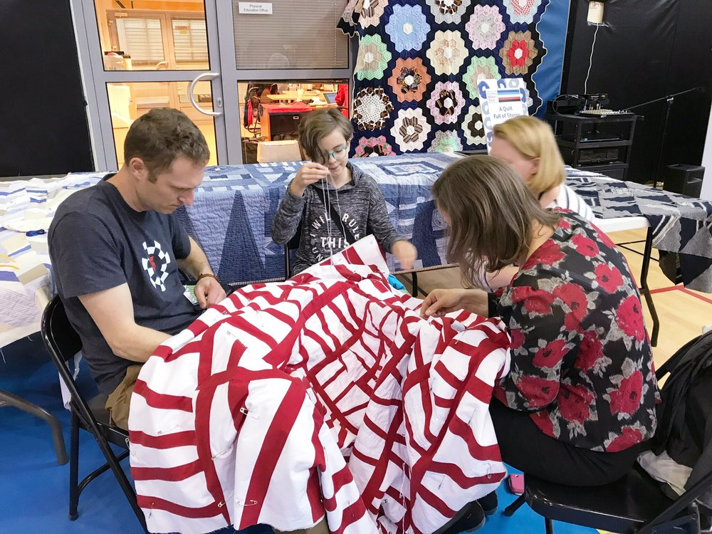 Handquilting a Modern Improv Quilt at a School Maker's Faire