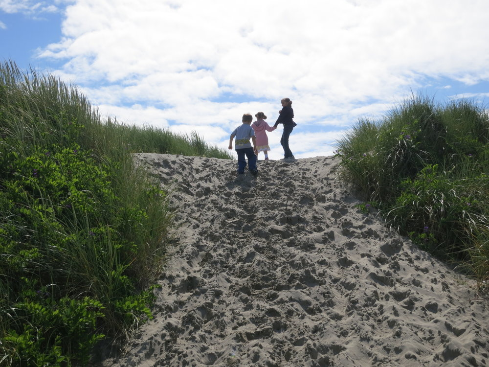 Walking up the sand dunes on the Oregon coast
