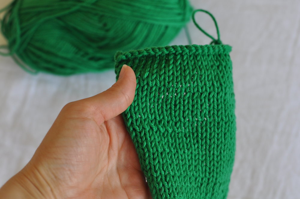 Knitting a swatch sample to test knitting gauge