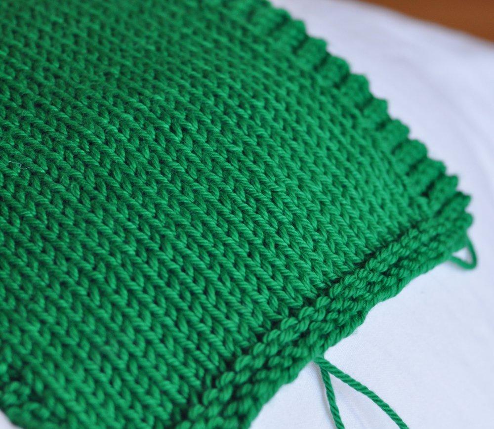 Knitting a swatch sample to test knitting gauge
