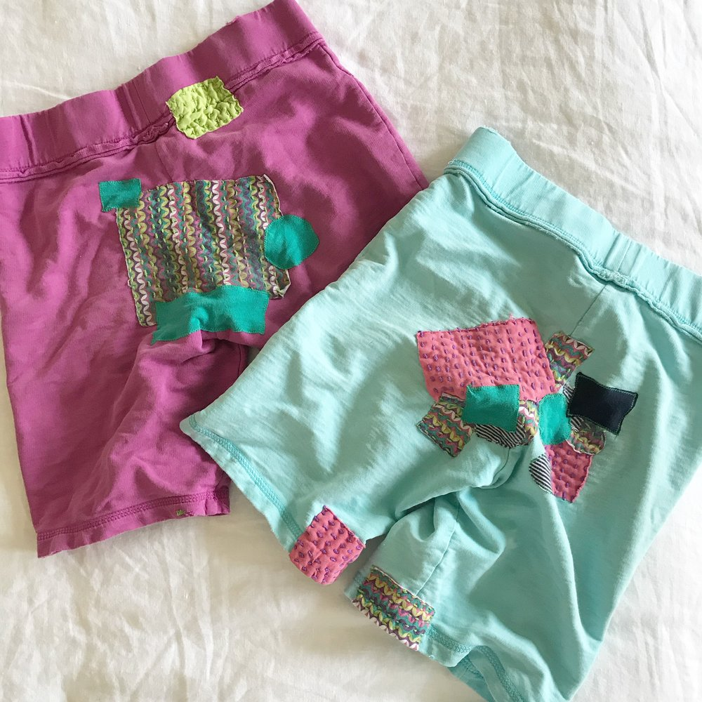 Visible mending on child's shorts