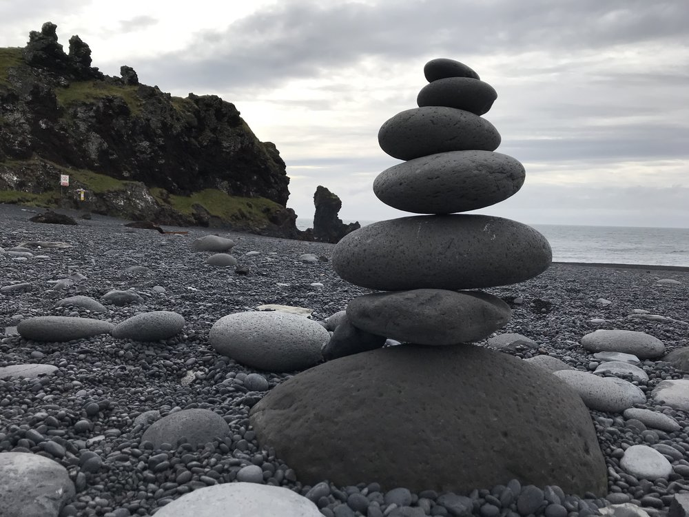 Stacked rocks at a black sand beach in Iceland