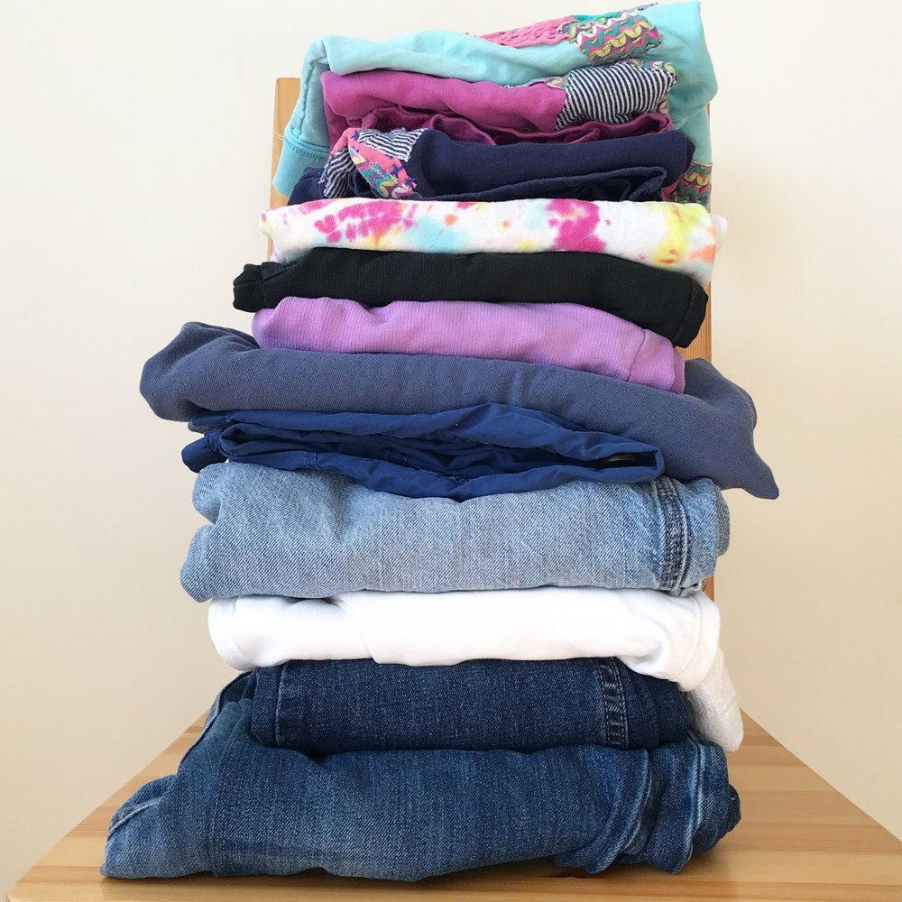Stacked mended clothing