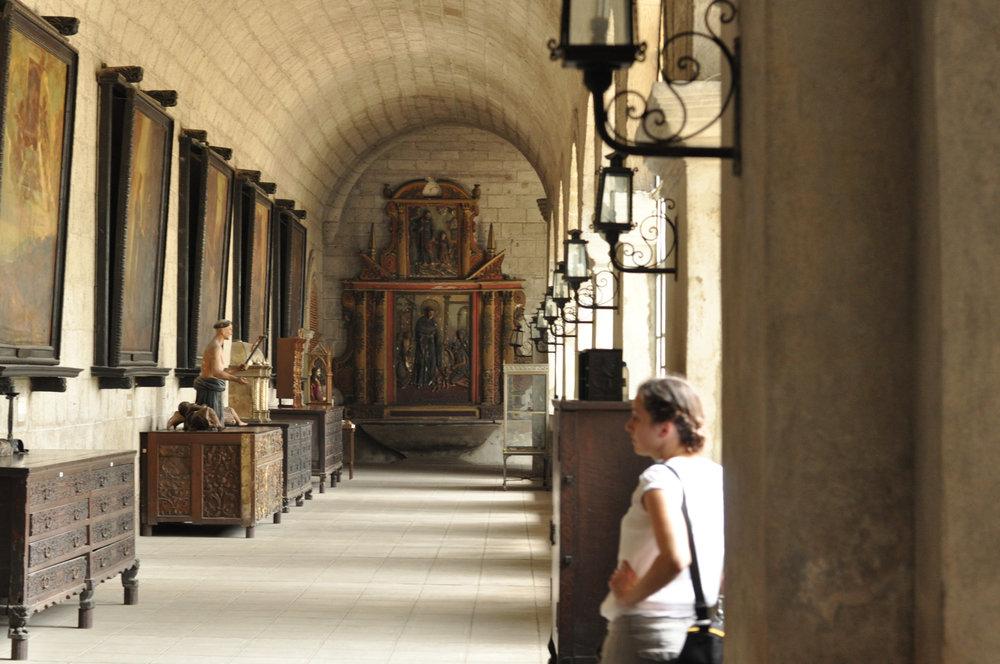 Corridor lined with art in San Agustin Church, Intramuros, Manila Philippines