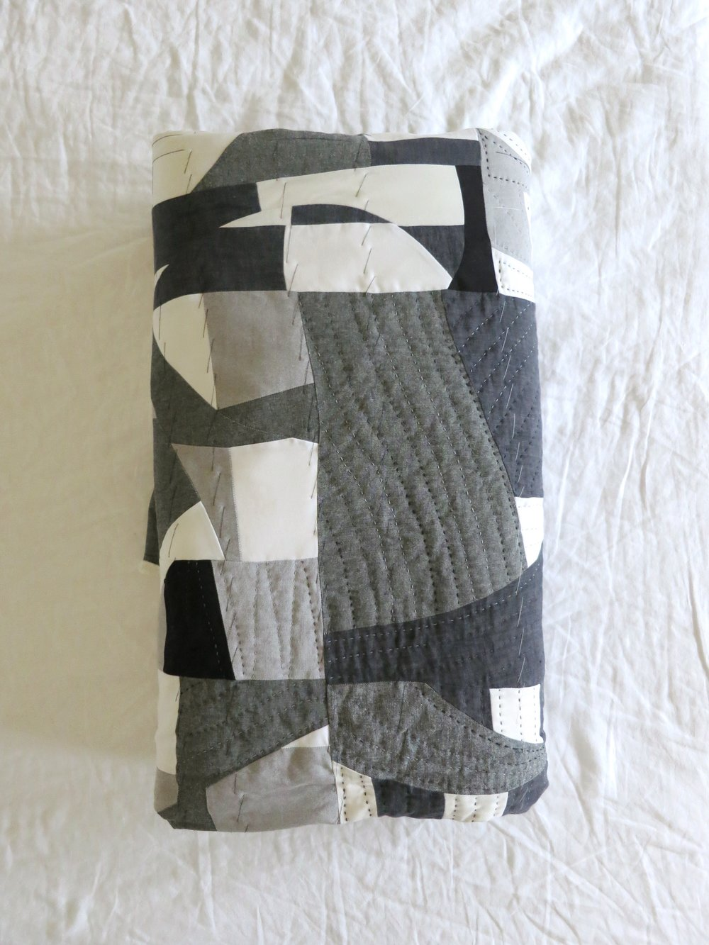Black, white and grey quilt—basted and partially hand-quilted