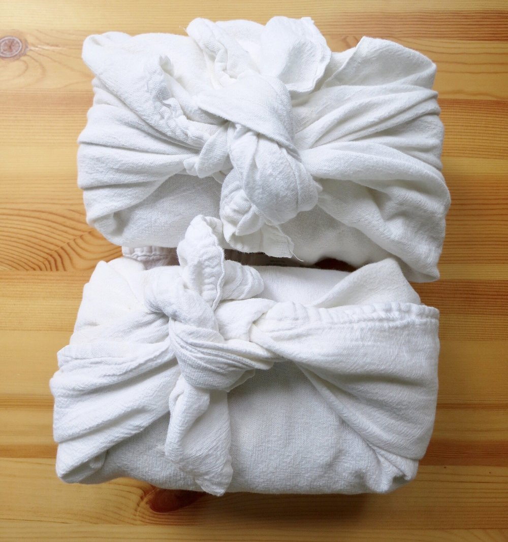 Fresh baked bread wrapped in dish towels—a tiny gratitude in my life.