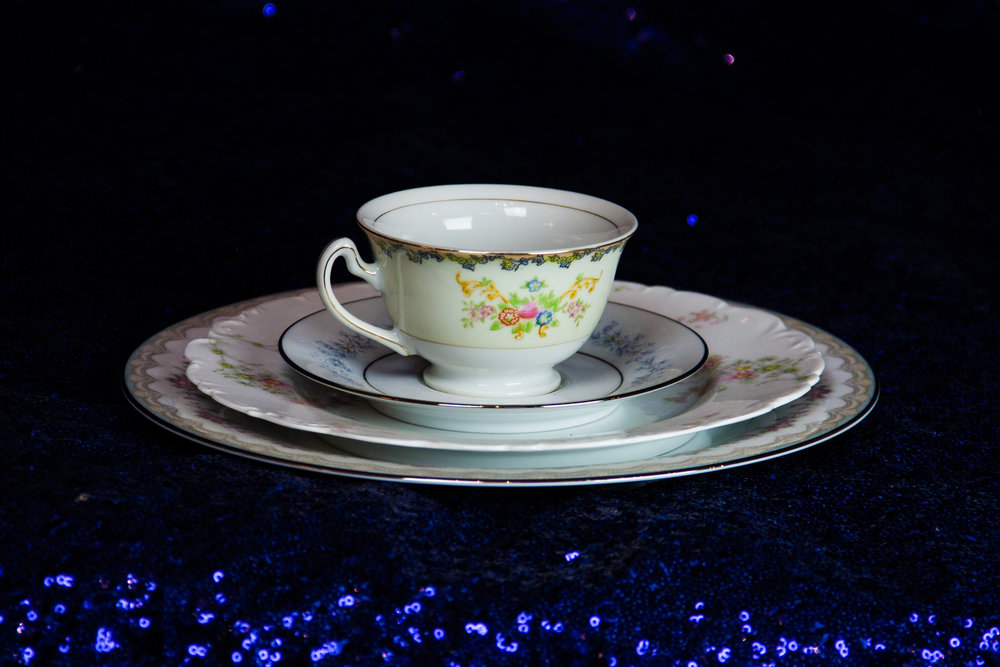 Assorted Patterned China Cups and Saucers