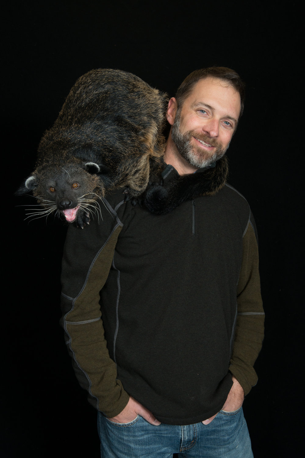 CCAD alum Grahm Jones with a binturong. Photo by Amanda Carberry