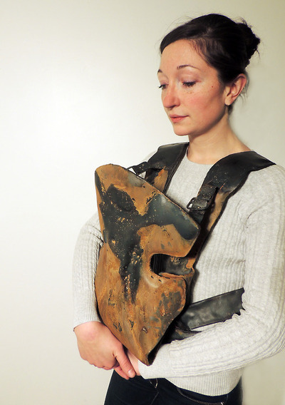 "Hilliard-Koshinsky wearing a Baby Bjorn. Neglect was welded, fabricated and inflated out of 20-gauge steel. ""Some of my work is about being left and some of my work is about what you take with you physically and psychologically,"" she said."