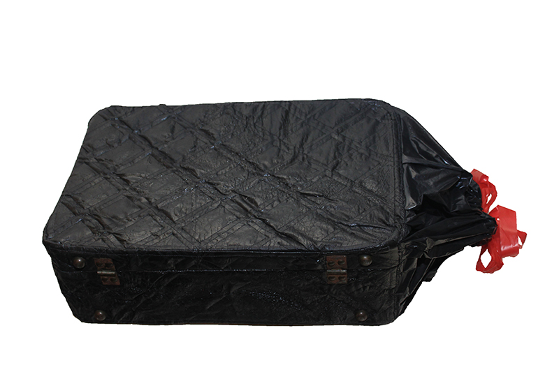 "Universal Luggage of Foster Care is a suitcase built on a steel armature with an exterior of quilted, branded Hefty 30-gallon trash liners.  "" Garbage bags facilitate the disposal of objects that are no longer of value, and they are also used to grab belongings in haste when leaving is not planned. By quilting them as one would fabric, I have invested in the suitcase and garbage bag. I have given the garbage bag a more permanent, dignified form to reside upon in the form of luggage, ""  Hilliard-Koshinsky said."