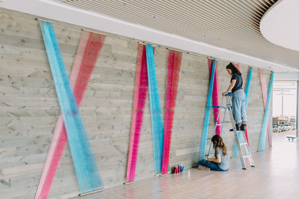 Rachel Mica Weiss  installs her commissioned work at BCG. Photo courtesy of Nicole Baas.