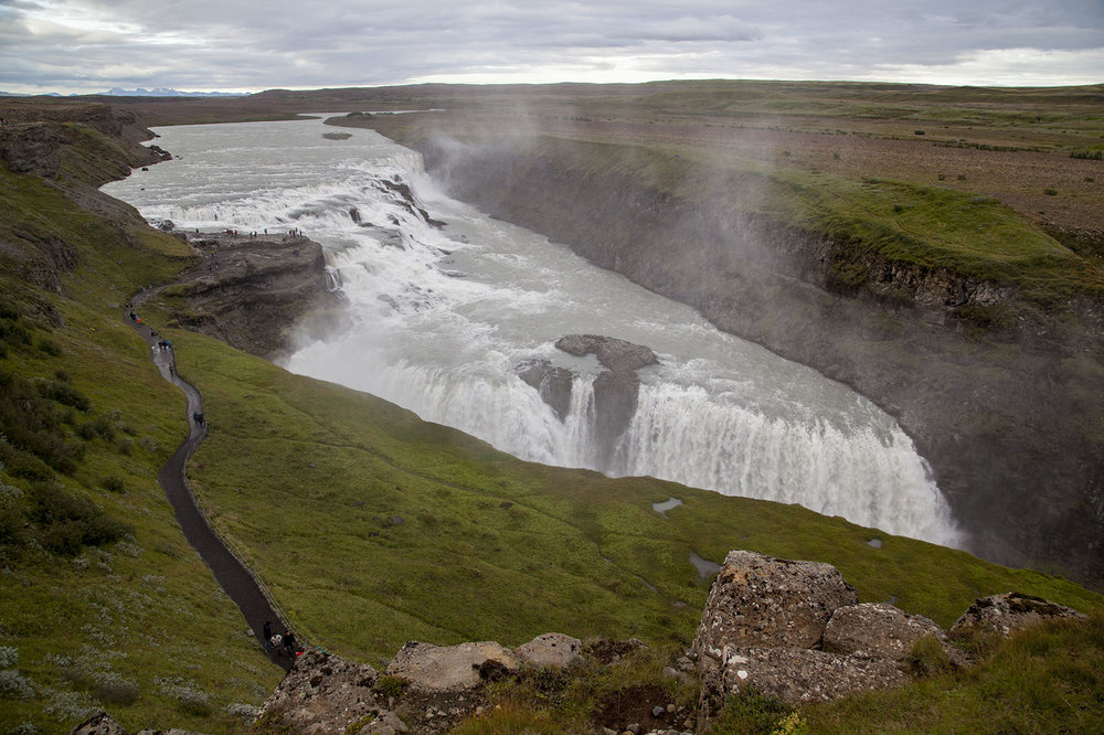 Gullfoss Waterfall, located on Iceland's Golden Circle Tour, is of of Icelands most visited waterfalls. The water from the  Ölfusá River falls 32 meters.