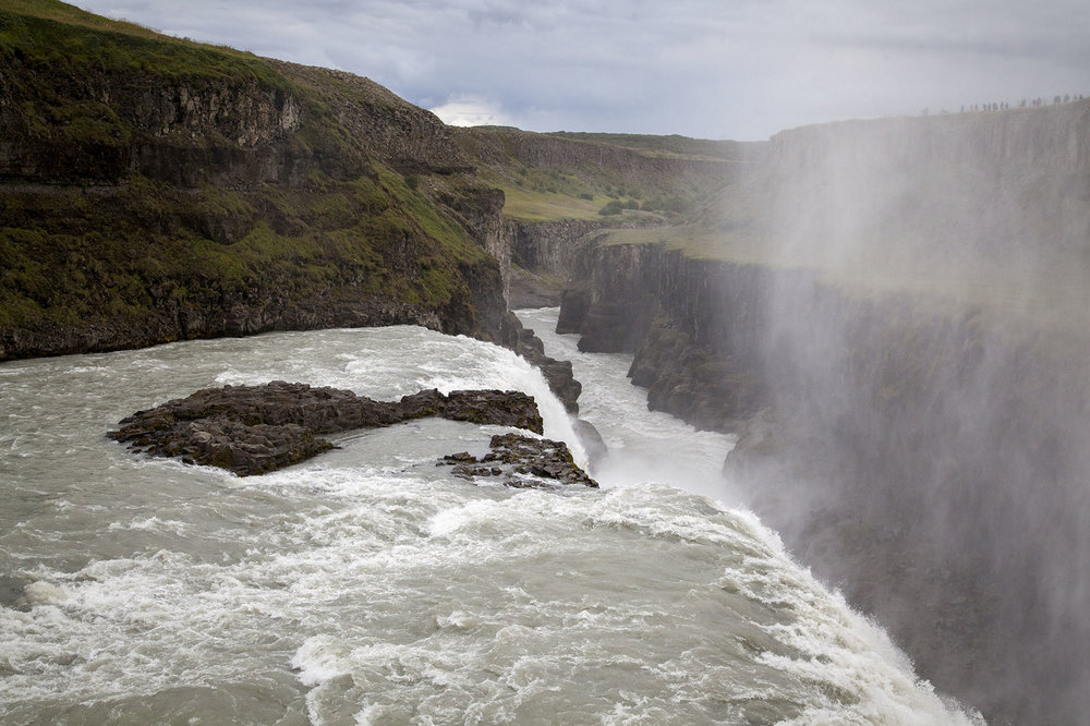 Gullfoss Waterfall, located on Iceland's Golden Circle Tour, is of of Icelands most visited waterfalls. The water from the  �lfus� River falls 32 meters.