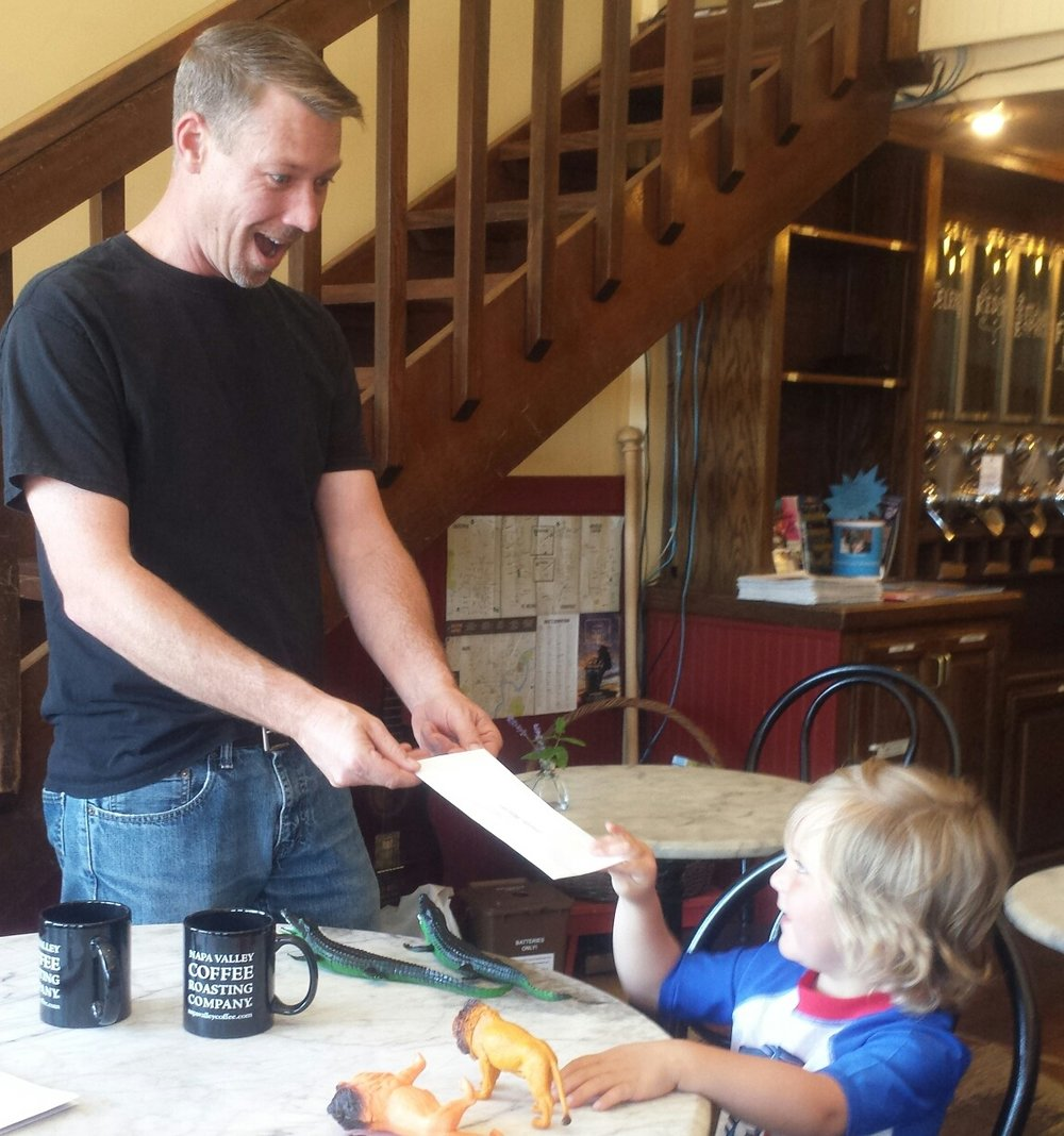 We had a successful event for Gunnar! Here he is collecting a check from our June 6th Caffeinate and Donate event.