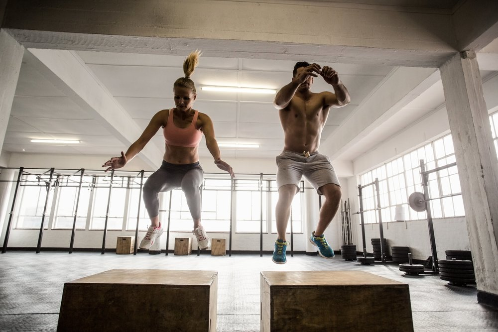 fit-couple-doing-set-of-box-jumps-60551228.jpg