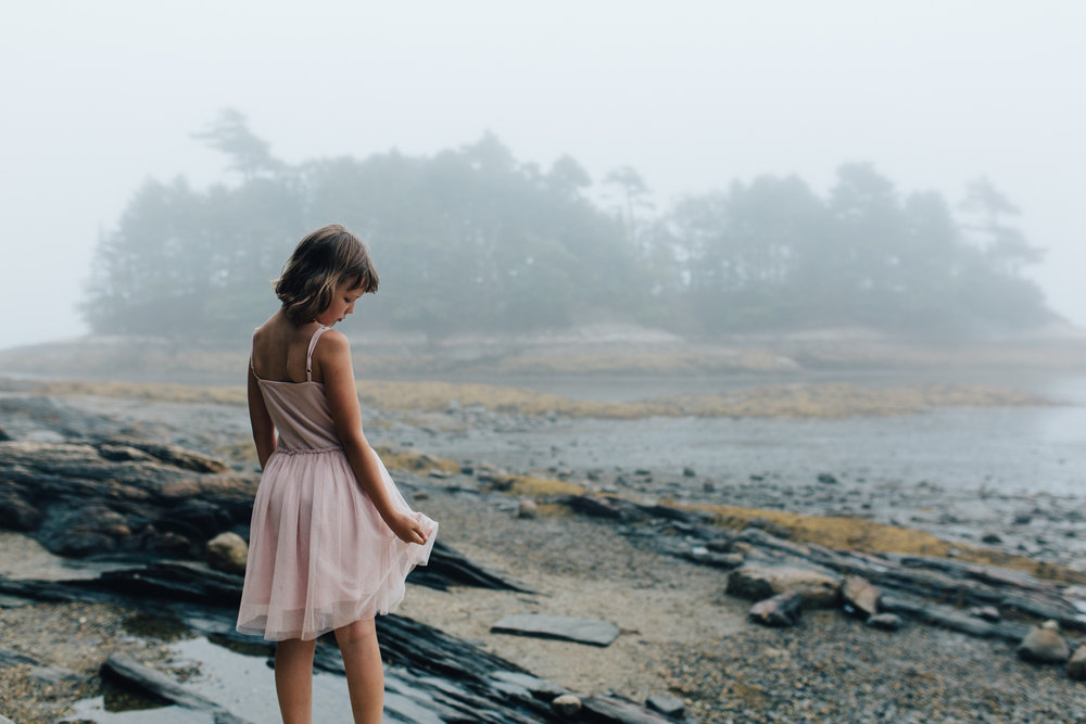 girl along the foggy midcoast beach