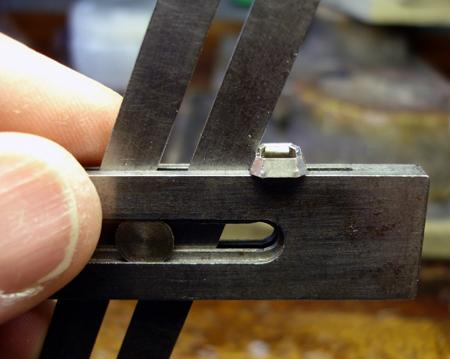 Check the angle of the facets of the bezel for uniformity with a bevel angle gauge.