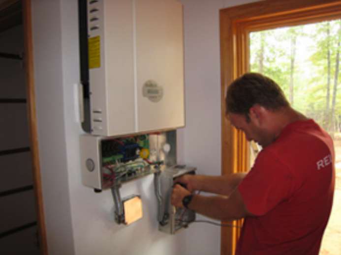 "Multiple panels in a ""string"" connect to a single string inverter, often located inside the home or business."