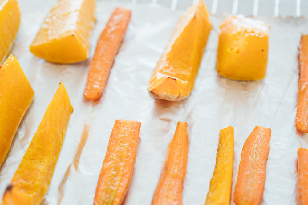 Butternut squash & carrots - oven roasted and ready to be simmered into a creamy fragrant soup.