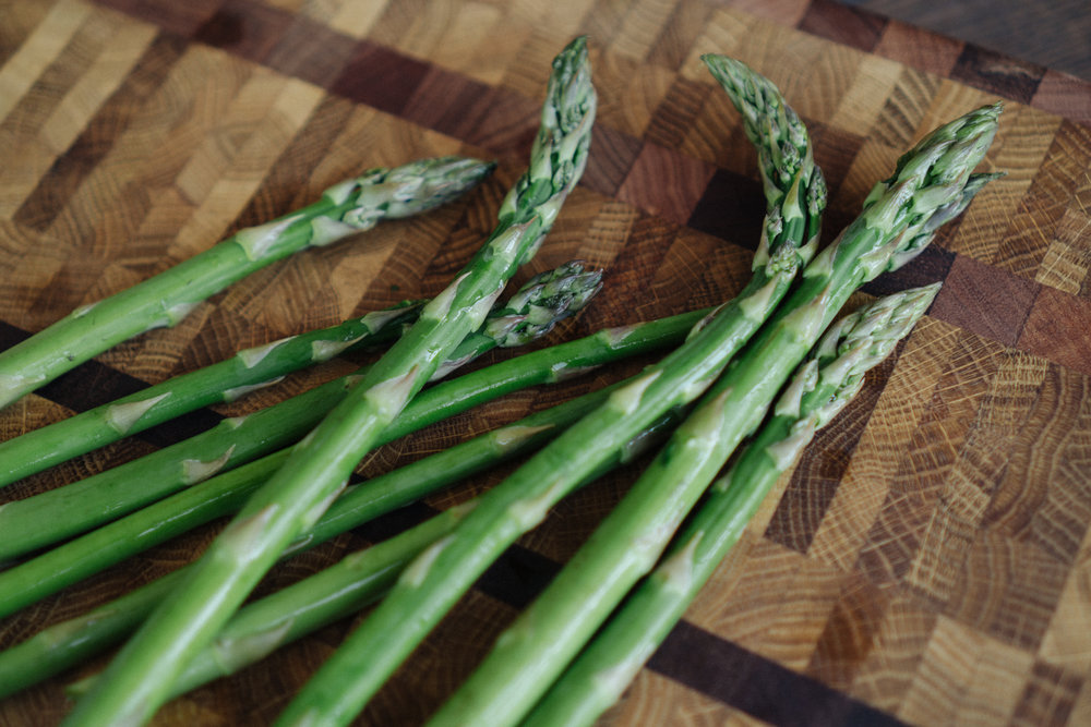 Wash asparagus and cut off the woody stalk ends.