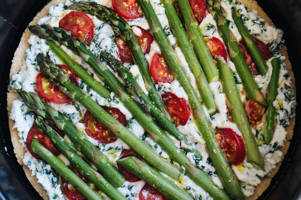 Top with cherry tomatoes, asparagus and a drizzle of olive oil. Bake for about 40 minutes.