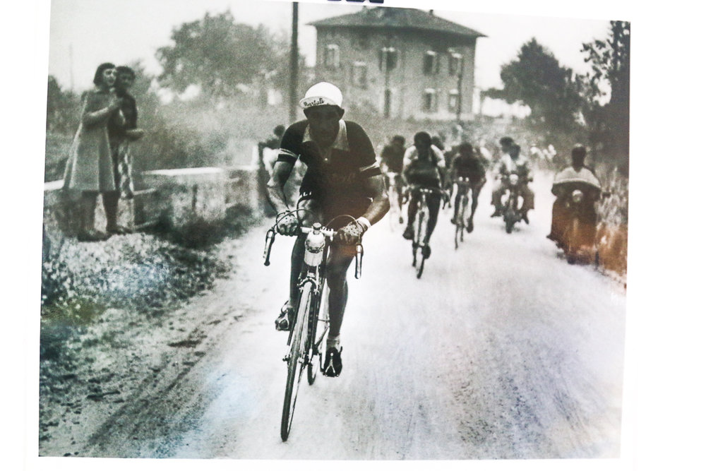 Gino Bartali racing the Giro di Lombardia past Hotel Il Perlo...and the owner's teenage aunts watching him race by!