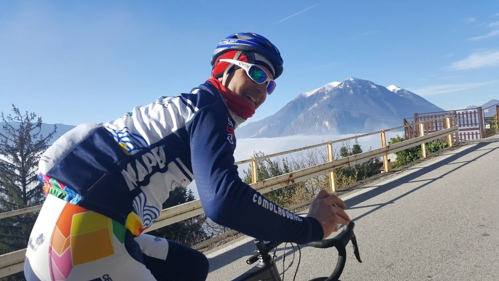ComoLagoBike founder and President, Luca Molteni, riding above the clouds.