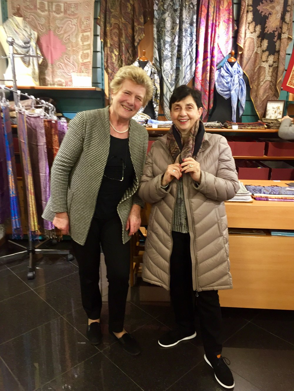 My mom receiving wonderful assistance in buying a silk scarf from the owner of Azalea in Bellagio.