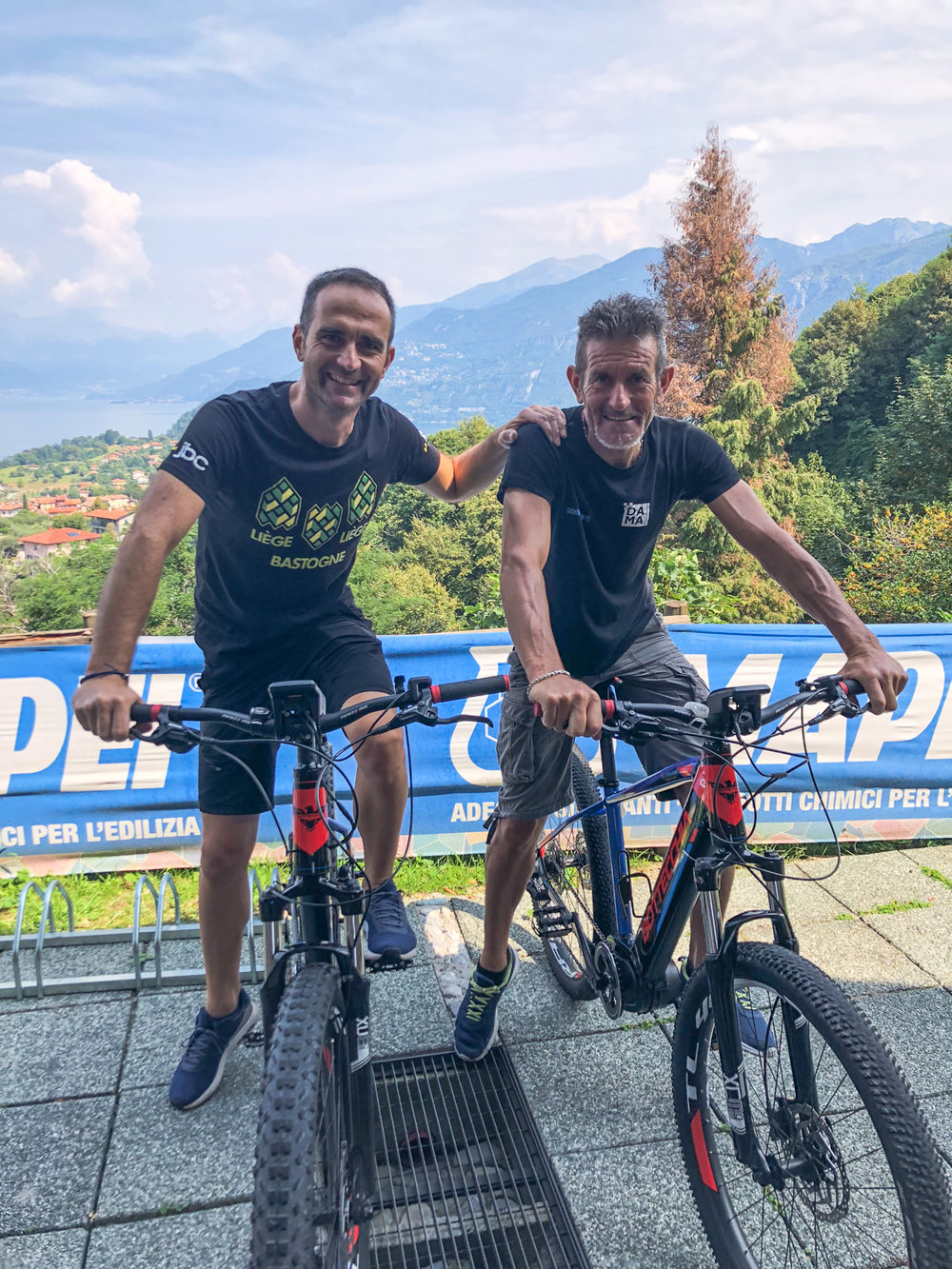 ComoLagoBike president, Luca, with Alberto waiting for you in front of the bike shop and rental point.