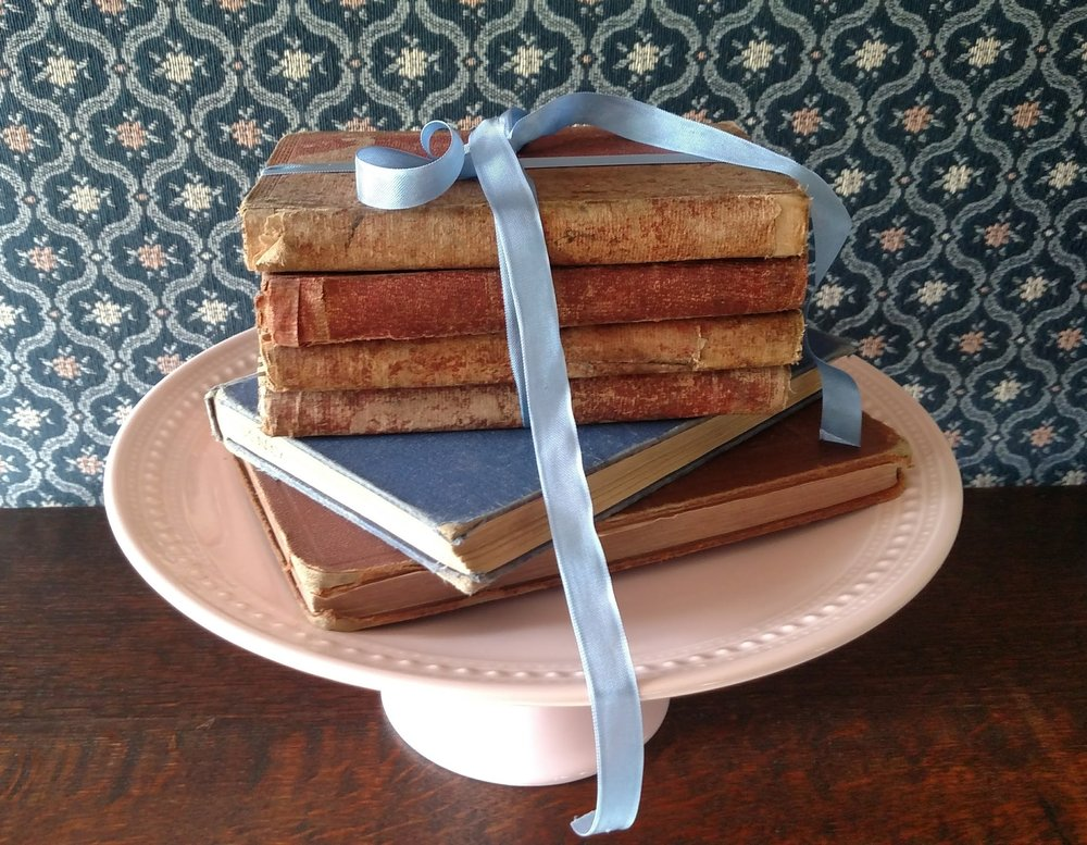 Stacked Books on Pink Cake Stand.jpg