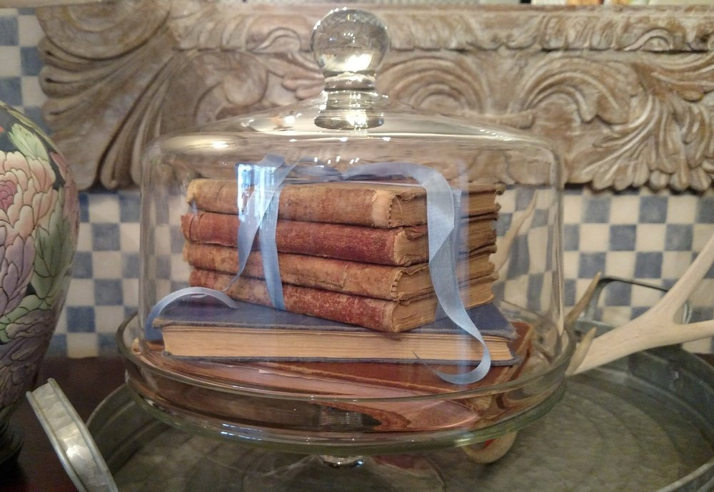 Stacked Books on Glass Cake Plate.jpg