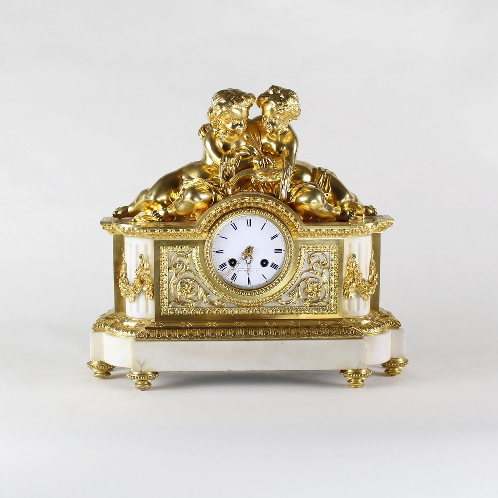 French gilt-bronze and white marble mantel clock by Perrelet et Fils