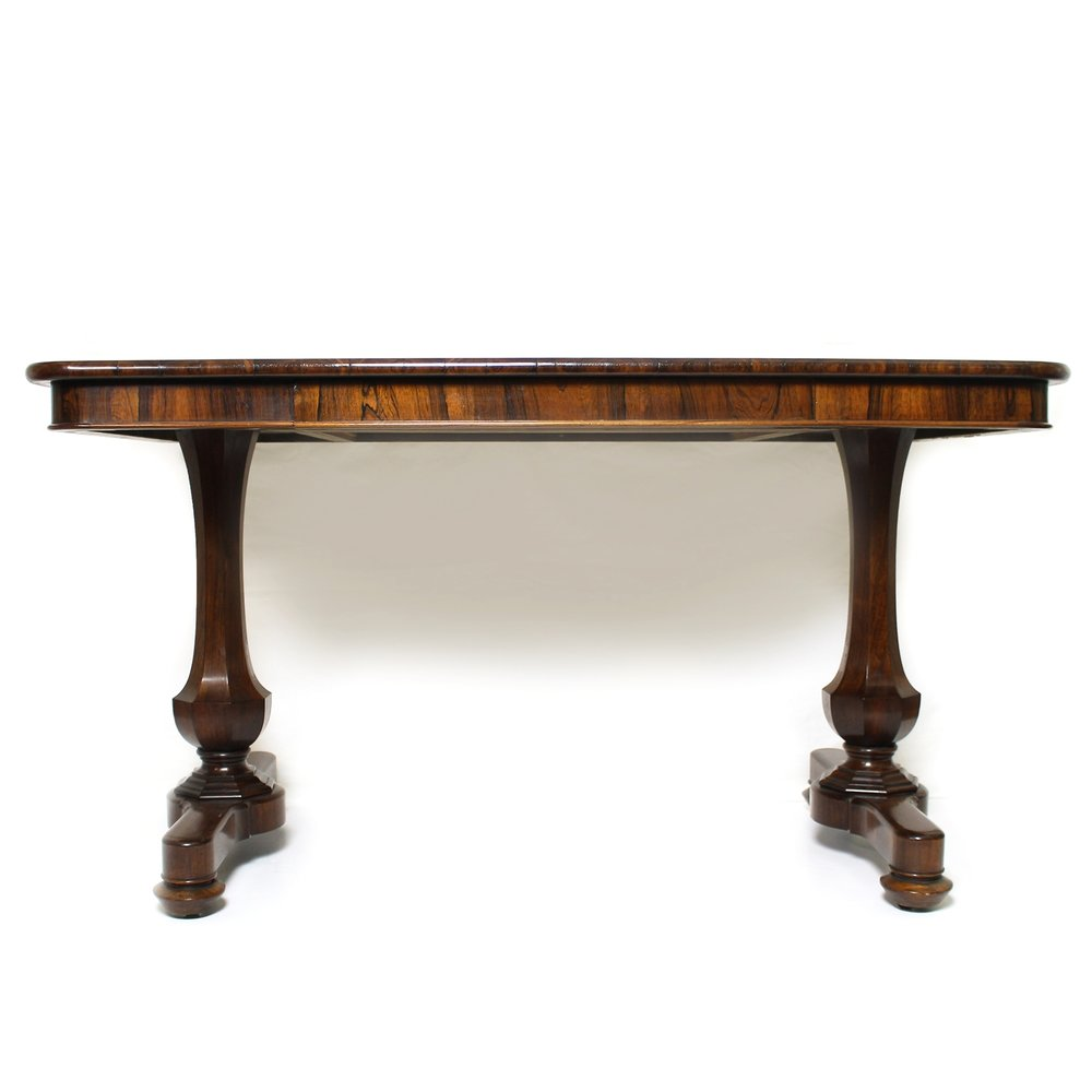 Fine library table with signed frieze drawer and octagonal end supports, English circa 1825