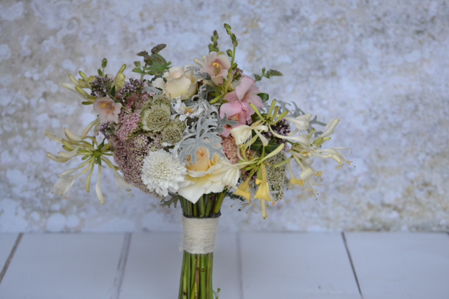 Peachy pink Antirrhinum pink trumpet in this July wedding bouquet.