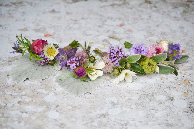 Corsages and buttonholes, using the pink and purple shades from the bouquet, but all individual.