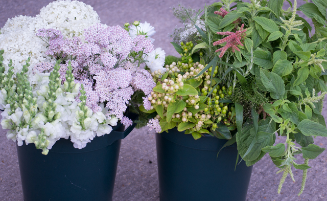 DIY buckets of flowers, to a green, white and pastel theme, ready to go.