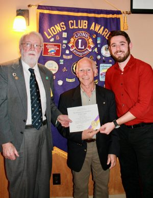 David Garber is welcomed to Lions by Past President Robert Weston, left, and President Zach Merry, right.