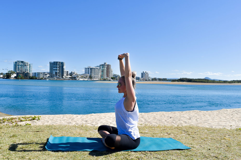 Spinal Extension: Continue to clasp the fingers as you inhale to lie the chest and reach the arms up toward the sky.