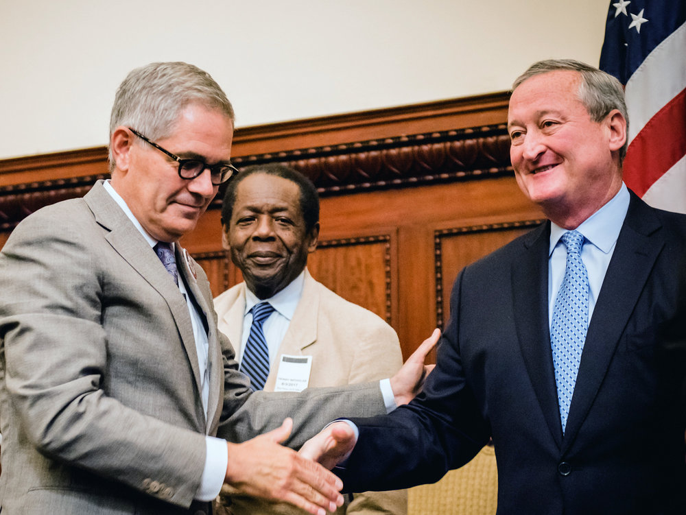 Krasner and Kenney shake hands as President Henry Nicholas of AFSCME District 1199C looks on. (Photo: Cathie Berrey-Green)