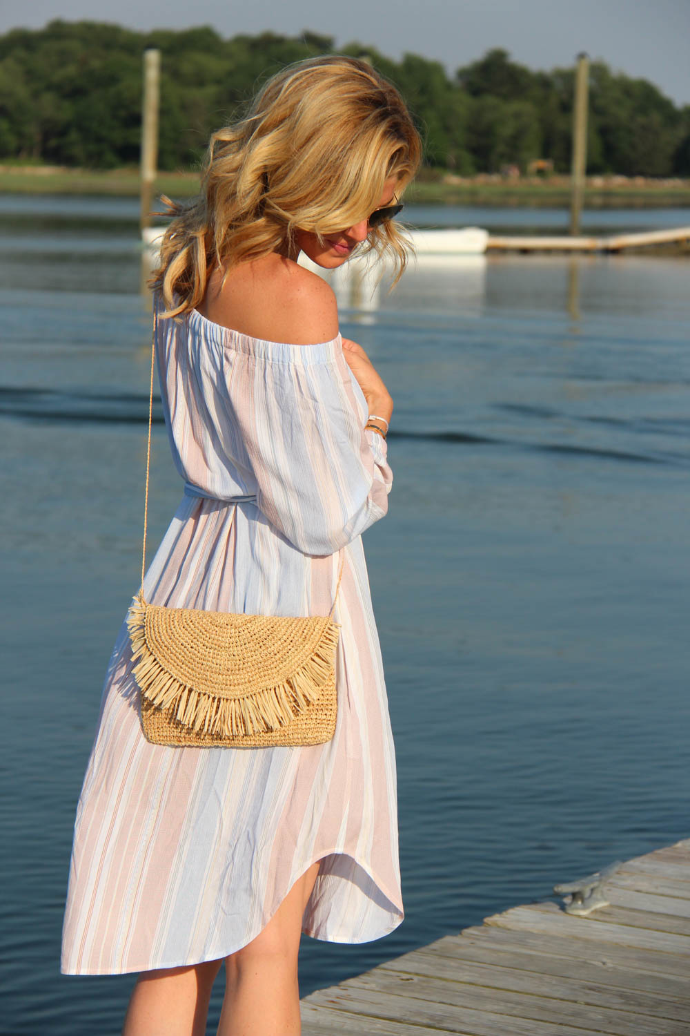 AG MICHELLE OFF-SHOULDER STRIPED DRESS | $198  HAT ATTACK SUNSHINE CLUTCH | $94