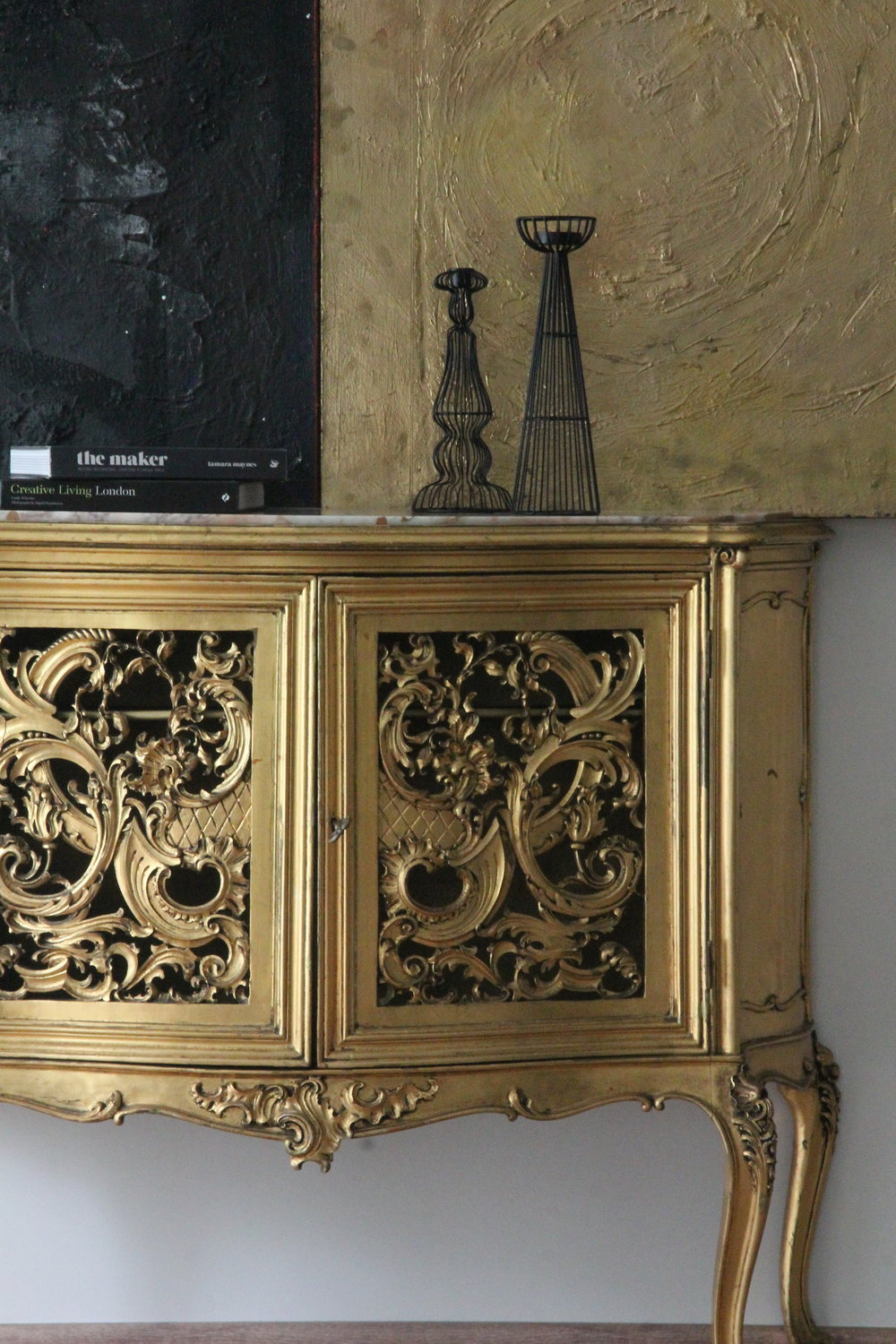 Antique sideboard and artwork