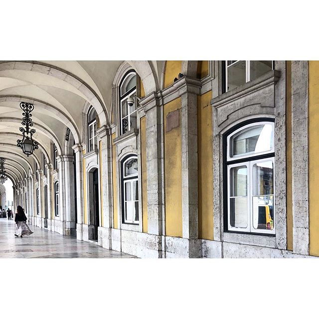 ~ she walks ~  #lisboa #portugal #citycrush #memories #arcade #architecture #streetlight #windows #pastel #kindofyellow #silhouette #atmosphere #silence #wanderlust #travel #minimalmood