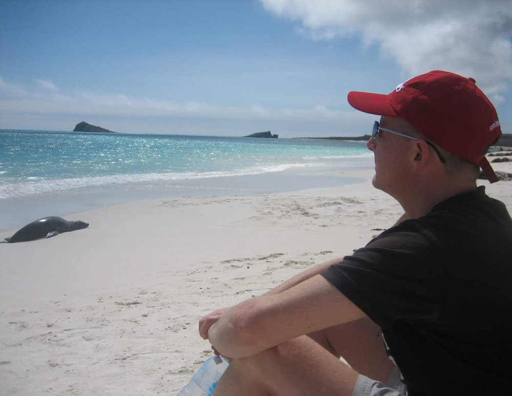 Brent relaxing by the sea in the Galapagos Islands