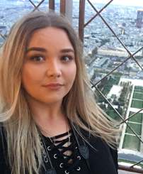Jamie enjoying her time on top of the Eiffel Tower