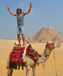 Aaron catching sight of 7 Pyramids of the Giza Plateau from a camel.