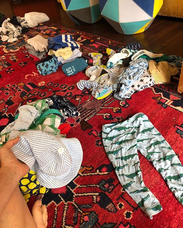 A couple times a year my living room looks like this. Sorting through the last season and sizes of the boys' clothing and making room for the next. Getting rid of the excess we somehow manage to continually accumulate. I don't usually get sad about my babes growing up. And I'm not sad right now, but as I folded these little alligator 🐊 PJ's to put away, I couldn't help but feel a little uneasy about the days and years ahead. I love that they laugh at me and play with me and get excited when Derek or I walk through the door. I love the joy in their little bodies and the lack of fear in their sweet eyes. I get sad about them getting older and experiencing the world and getting hurt and feeling pain and having reason to fear. So I guess that's what I like about them being little. They don't know yet. I know pain and sorrow isn't the worst. But sometimes i just wanna be one-sided and pretend this is all they'll ever experience. Wrestling with dad and playing pretend and making up songs with mom. And just all the giggles in all the land. And squeezey little thighs with no body image issues 😂😂 #butForRil