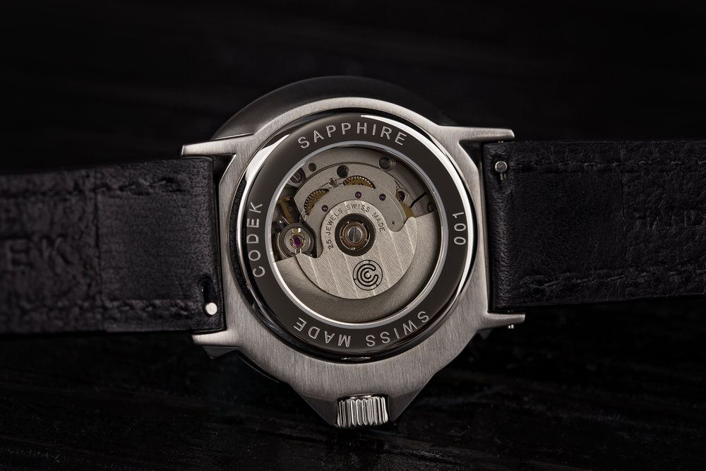 MOVEMENT - The reverse of the Spiral is equally attractive. It features a sapphire crystal display caseback encompassed with an engraved serial number. Peering through the glass is the engine of the spiral: the venerable ETA 2824 automatic movement.Each movement is tested and regulated in 3 positions by a watchmaker. The amplitude and beat error are also evaluated. On a full wind, the timing is expected to be well within -3/+6 sec/day.